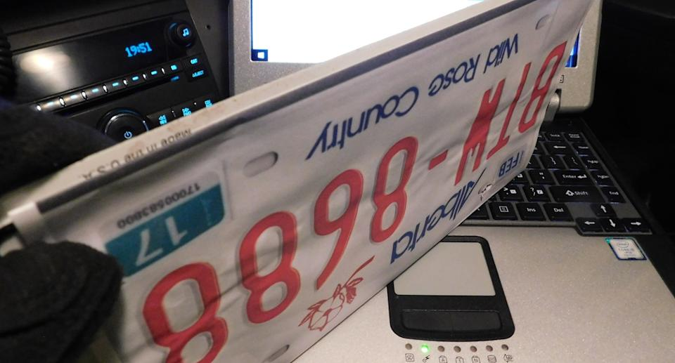 Fake licence plates printed on paper are pictured.