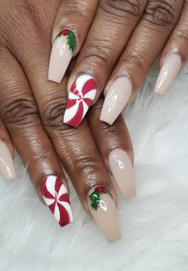 "<p><a href=""https://www.instagram.com/naildbytammy/"" rel=""nofollow noopener"" target=""_blank"" data-ylk=""slk:Nail artist Tammy"" class=""link rapid-noclick-resp"">Nail artist Tammy</a> added in a whimsical peppermint candy-inspired swirl to add a pop of red to this Christmas manicure.</p><p><a class=""link rapid-noclick-resp"" href=""https://go.redirectingat.com?id=74968X1596630&url=https%3A%2F%2Fwww.etsy.com%2Flisting%2F556123604%2Fpeppermint-candy-stencils-for-nails&sref=https%3A%2F%2Fwww.oprahmag.com%2Fbeauty%2Fg34113691%2Fchristmas-nail-ideas%2F"" rel=""nofollow noopener"" target=""_blank"" data-ylk=""slk:SHOP NAIL STENCIL"">SHOP NAIL STENCIL</a></p>"