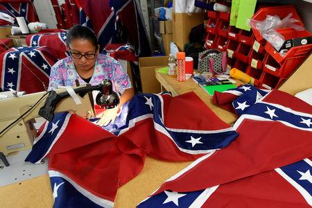 Blanca Hernandez sews stars on a Confederate Battle Flag in the Alabama Flag & Banner shop in Huntsville, Alabama, U.S., August 24, 2017. REUTERS/Harrison McClary