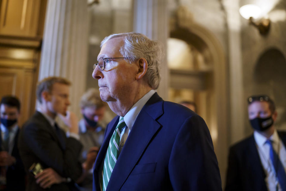 Senate Minority Leader Mitch McConnell, R-Ky., walks past the chamber as the Senate advances to formally begin debate on a roughly $1 trillion infrastructure plan, a process that could take several days, at the Capitol in Washington, Friday, July 30, 2021. (AP Photo/J. Scott Applewhite)