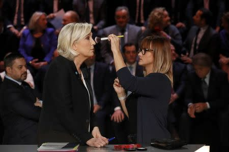 Candidate for the 2017 presidential election Marine Le Pen, French National Front (FN) political party leader, gets make-up before a debate organised by French private TV channel TF1 in Aubervilliers, outside Paris, France, March 20, 2017. REUTERS/Patrick Kovarik/Pool