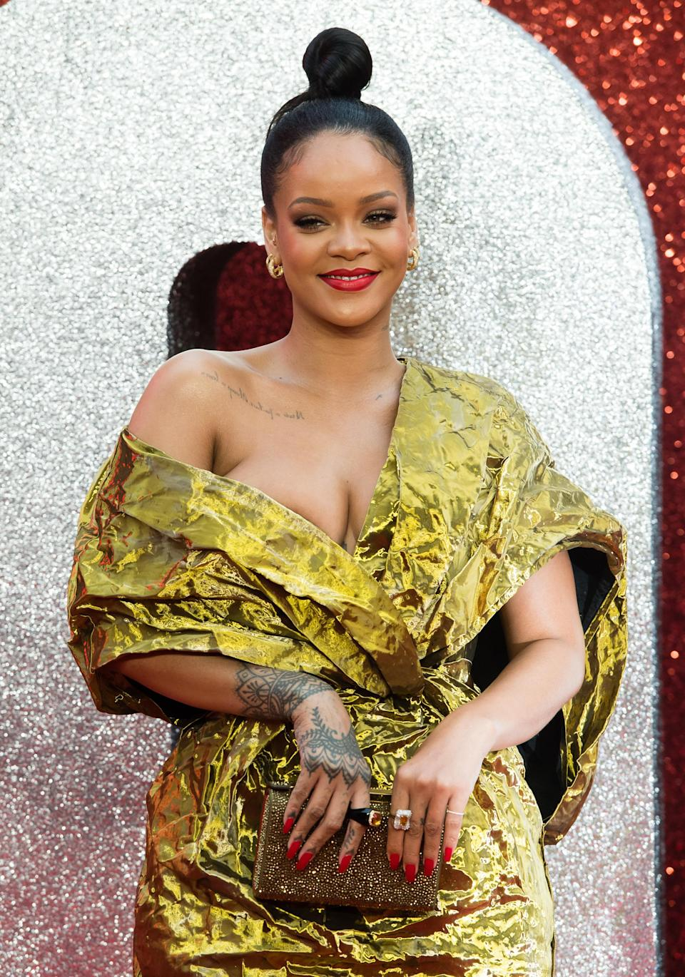 <p>Rihanna reportedly has 25 tattoos. The Egyptian Goddess Isis is inked below her chest and is easily her most famous. The tatt is reportedly in memory of her grandmother Dolly. Other inks include a splattering of stars on her neck and 'Shhh…' emblazoned on her finger. <em>[Photo: Getty]</em> </p>