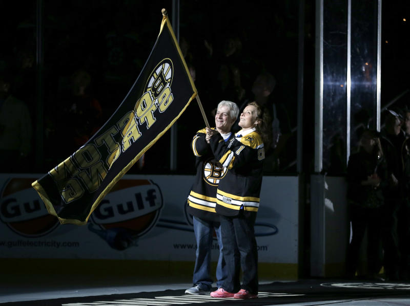 "William and Patricia Campbell, parents of Krystle Campbell, who was killed in the Boston Marathon bombings, wave a ""Boston Strong"" banner before Game 4 in the Eastern Conference finals of the NHL hockey Stanley Cup playoffs between the Boston Bruins and the Pittsburgh Penguins, in Boston on Friday, June 7, 2013. (AP Photo/Elise Amendola)"