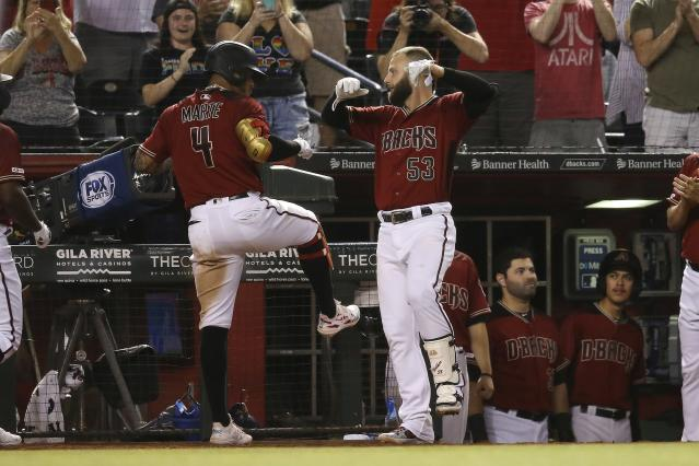 Arizona Diamondbacks' Ketel Marte (4) celebrates his grand slam against the San Diego Padres with Christian Walker (53) during the seventh inning of a baseball game Wednesday, Sept. 4, 2019, in Phoenix. (AP Photo/Ross D. Franklin)