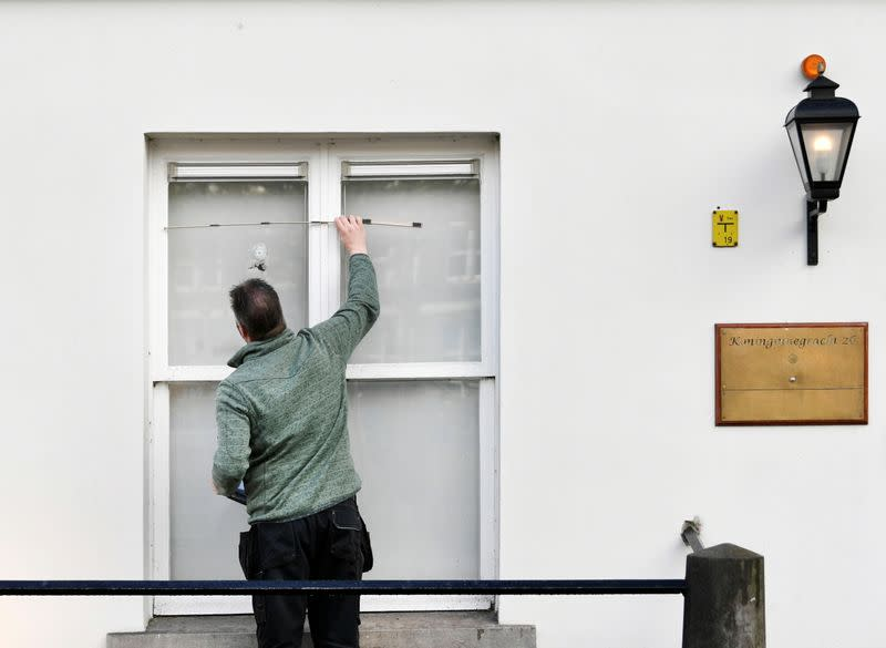 A bullet hole in the window of the Embassy of Saudi Arabia is pictured after unidentified assailants sprayed it with gunfire, in The Hague