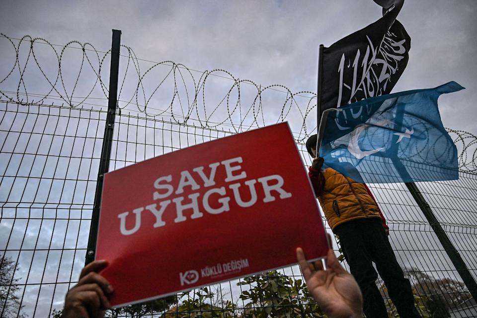 A supporters of China's Muslim Uighur minority holds a placard reading 'Save Uighur' during a demonstration in front of China Consulate in Istanbul.Photo: Ozan Kose/AFP/Getty
