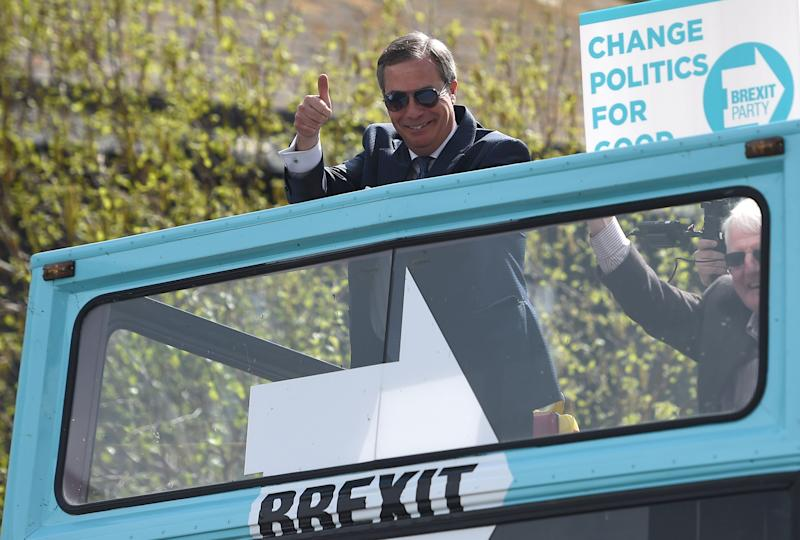 Brexit Party leader Nigel Farage arrives on an open top bus for a walkabout and rally in Clacton-on-Sea, Essex.
