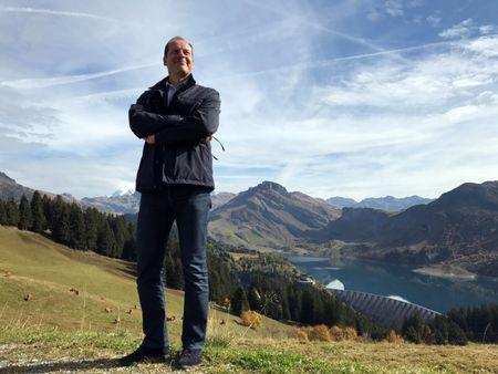 Tour de France director Christian Prudhomme poses in the Alps at the Col des Glieres which will feature on the first mountain stage in the Alps in the 2018 edition of the cycling event, near Le Petit-Bornand-les-Glieres, France, September 29, 2017. Picture taken September 29, 2017. REUTERS/Julien Pretot