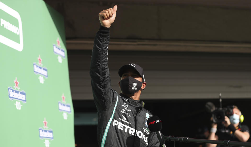 Mercedes driver Lewis Hamilton of Britain gives the thumbs up after clocking the fastest time during qualification for the Formula One Portuguese Grand Prix at the Algarve International Circuit in Portimao, Portugal, Saturday, Oct. 24, 2020. Hamilton will take pole position for the Formula One Portuguese Grand Prix which takes place on Sunday. (Jose Sena Goulao, Pool via AP)