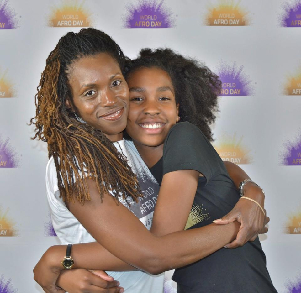 Michelle De Leon with her daughter Estelle at the first World Afro Day in 2017 (RB Incite Photography)