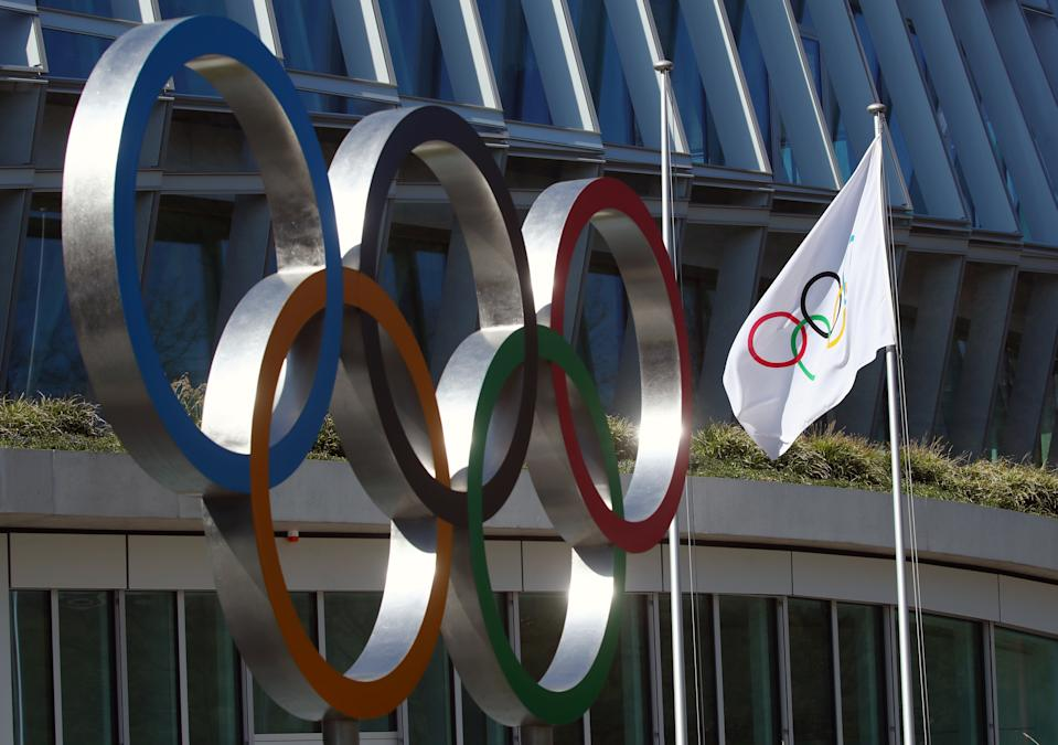 The Olympic rings are pictured in front of the International Olympic Committee (IOC) during the coronavirus disease (COVID-19) outbreak in Lausanne, Switzerland, March 24, 2020. REUTERS/Denis Balibouse