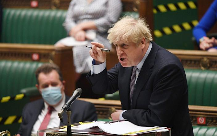 In this handout photo provided by UK Parliament, Britain's Prime Minister Boris Johnson speaks during Prime Minister's Questions at the House of Commons,