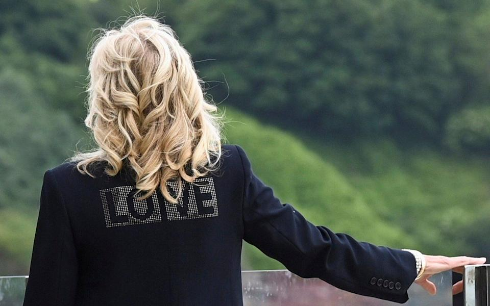 """First Lady Jill Biden wearing a jacket with the word """"Love"""" - Reuters"""