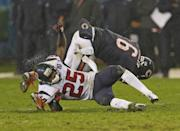 Jay Cutler #6 of the Chicago Bears is hit by Kareem Jackson #25 of the Houston Texans at Soldier Field on November 11, 2012 in Chicago, Illinois. The Texans defeated the Bears 13-6. (Photo by Jonathan Daniel/Getty Images)
