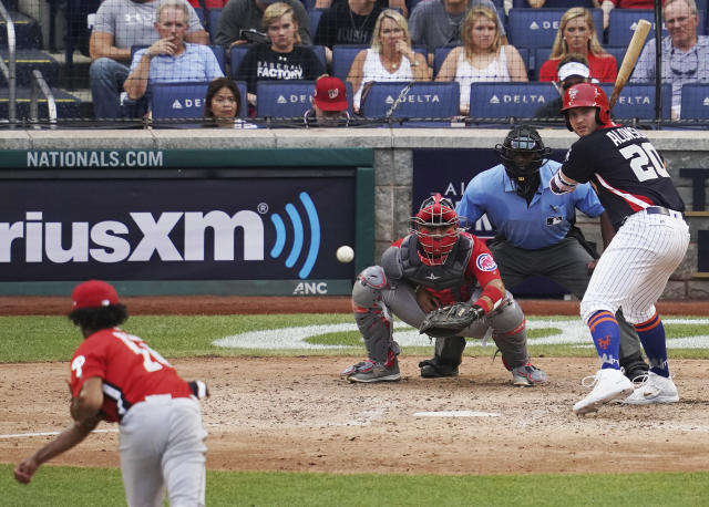 U.S. Team Peter Alonzo, of the New York Mets prepares to hit a home run against the World Team in the seventh inning of the All-Star Futures baseball game, Sunday, July 15, 2018, at Nationals Park, in Washington. The the 89th MLB baseball All-Star Game will be played Tuesday. (AP Photo/Carolyn Kaster)