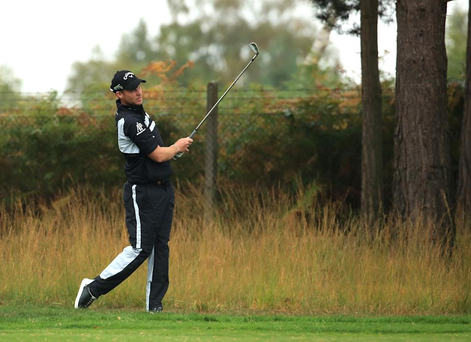VIRGINIA WATER, ENGLAND - SEPTEMBER 22: Danny Willett of England plays his second shot on the 9th hole during Day Four of the BMW PGA Championship at Wentworth Golf Club on September 22, 2019 in Virginia Water, United Kingdom. (Photo by Andrew Redington/Getty Images)