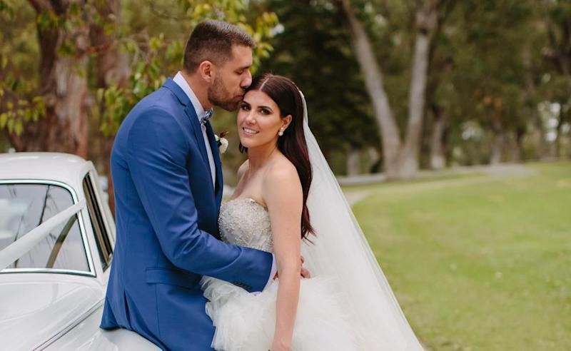 Wildcats player Tom Jervis and Jazze McNeil on their wedding day. Picture: Sarah Kate Dorman Photography