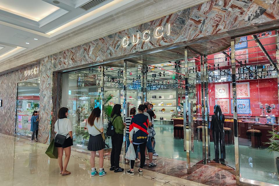 SHANGHAI, CHINA - JUNE 29, 2021 - Customers line up in front of the Gucci store at Daimaru Department Store on Nanjing East Road in Shanghai, China, June 29, 2021. (Photo credit should read Costfoto/Barcroft Media via Getty Images)