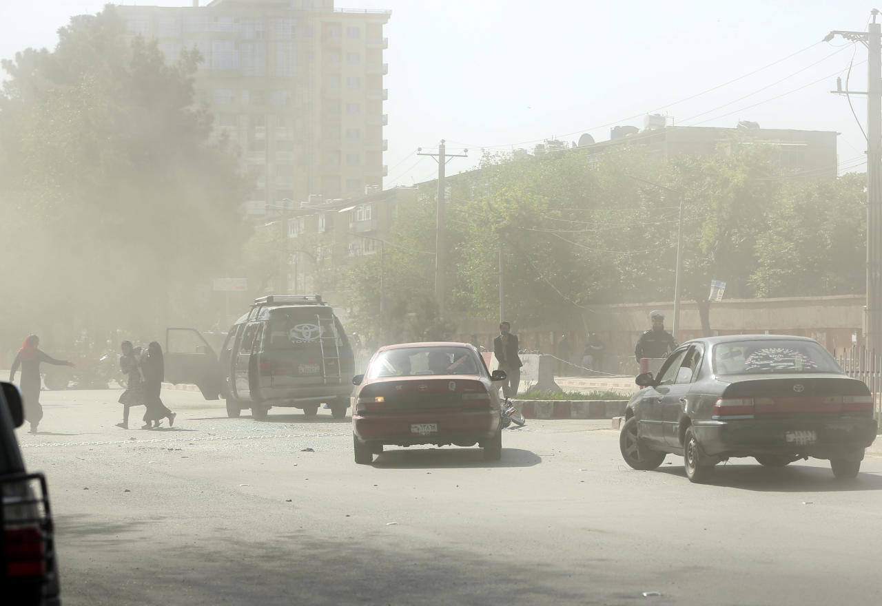 <p>People leave the site of a suicide attack after the second bombing in Kabul, Afghanistan, April 30, 2018. (Photo: Massoud Hossaini/AP) </p>
