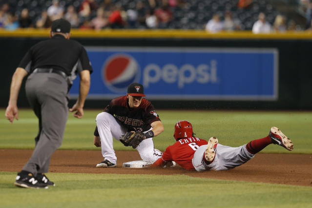 Cincinnati Reds' Phillip Ervin (6) is tagged out by Arizona Diamondbacks shortstop Nick Ahmed while trying to steal second base in the seventh inning during a baseball game Sunday, Sept. 15, 2019, in Phoenix. (AP Photo/Rick Scuteri)
