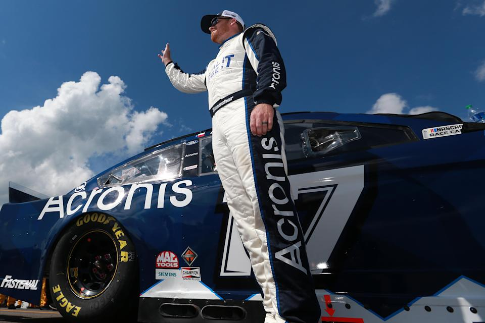LONG POND, PENNSYLVANIA - JUNE 27: Chris Buescher, driver of the #17 Acronis Ford, waves to fans on the grid prior to the NASCAR Cup Series Explore the Pocono Mountains 350 at Pocono Raceway on June 27, 2021 in Long Pond, Pennsylvania. (Photo by Sean Gardner/Getty Images) | Getty Images