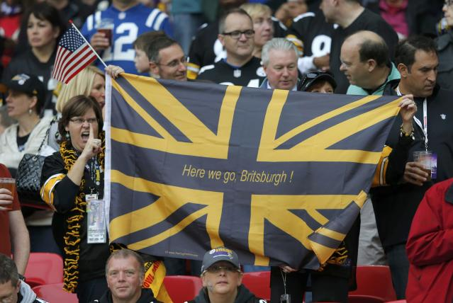 Pittsburgh Steelers fans hold a flag in the stands before the Steelers met the Minnesota Vikings in their NFL football game at Wembley Stadium in London, September 29, 2013. REUTERS/Eddie Keogh (BRITAIN - Tags: SPORT FOOTBALL)