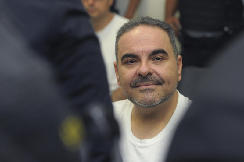 FILE - In this Aug. 8, 2018 file photo, El Salvador's former President Tony Saca attends an audience with a judge at the Isidro Menendez Judicial Complex in San Salvador, El Salvador, regarding charges of embezzling hundreds of millions of dollars in government funds in return for a lighter sentence. On Wednesday, Sept. 12, 2018, Saca was sentenced to 10 years in prison. (AP Photo/Salvador Melendez, File)