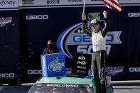 Brad Keselowski (2) celebrates after winning the Geico 500 NASCAR Sprint Cup auto race at Talladega Superspeedway, Sunday, April 25, 2021, in Talladega, Ala. (AP Photo/Butch Dill)
