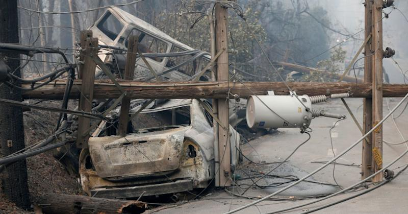 Burned cars and downed power lines are seen along Pearson Road in Paradise, Calif., on Saturday, Nov. 10, 2018. The Camp Fire is so far the most destructive wildfire in California history.