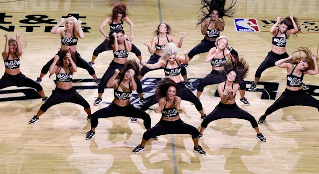 "The San Antonio Spurs said a 35-member ""hype team"" featuring acrobatics, dance, stunts and tumbling would be selected to replace the team's Silver Dancers dancing group (AFP Photo/Chris Covatta)"