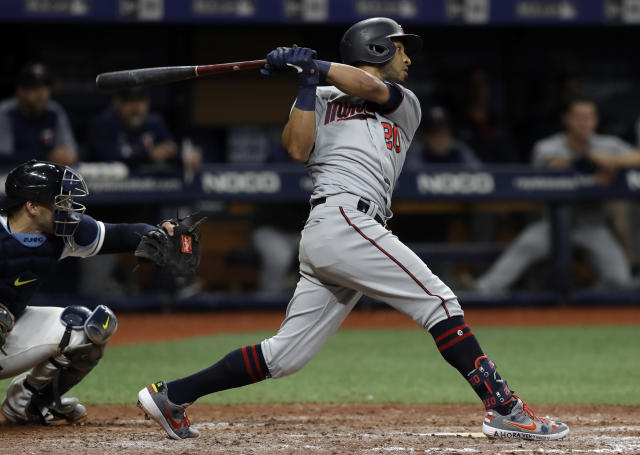 Minnesota Twins' Eddie Rosario follows through on a two-run single off Tampa Bay Rays relief pitcher Adam Kolarek during the ninth inning of a baseball game Friday, May 31, 2019, in St. Petersburg, Fla. (AP Photo/Chris O'Meara)