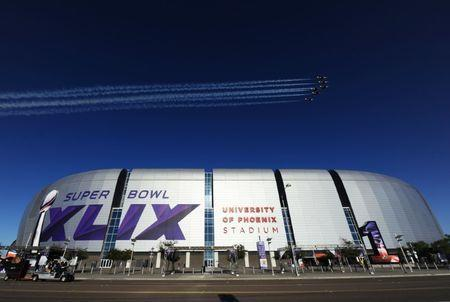 Feb 1, 2015; Glendale, AZ, USA; A general view of the flyover by the Thunderbirds during the national anthem before the start of Super Bowl XLIX between the Seattle Seahawks and New England Patriots at University of Phoenix Stadium. at University of Phoenix Stadium. Mandatory Credit: James Lang-USA TODAY Sports