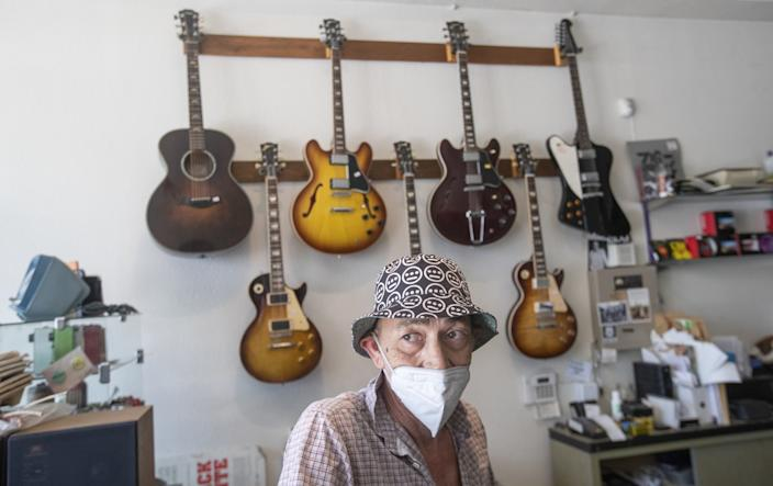 "Jack Waterson, owner of Future Music on York Blvd. in Highland Park. <span class=""copyright"">(Mel Melcon/Los Angeles Times)</span>"