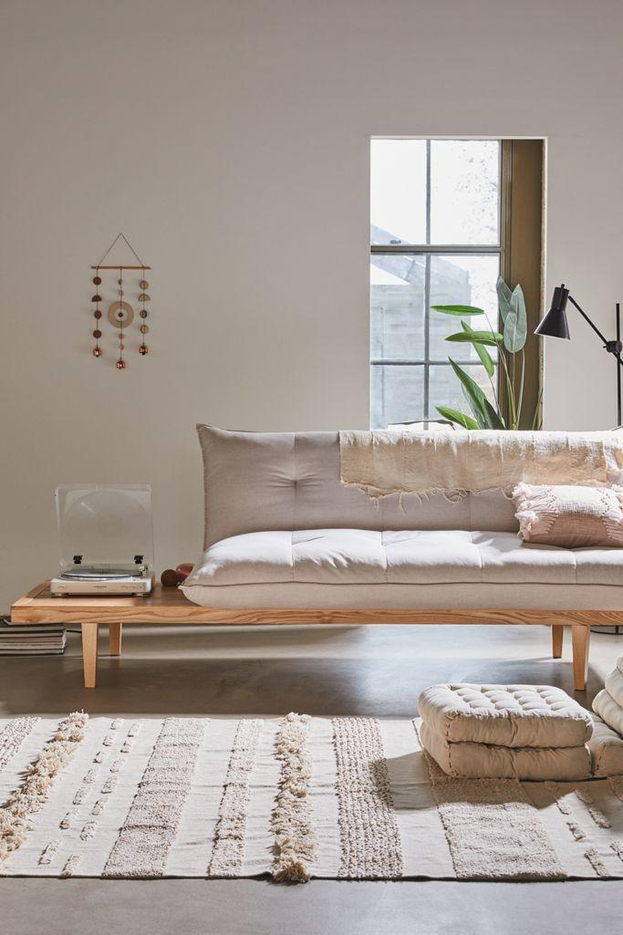 """<h2>Urban Outfitters Reid Side Table Convertible Sofa</h2><br>We're big fans of functional furniture that also packs a pleasing punch; just take a look at this sofa-table. With a side table built-in, you won't have to worry about reaching for the coffee table anymore. <br><br><strong>Urban Outfitters</strong> Reid Side Table Convertible Sofa, $, available at <a href=""""https://go.skimresources.com/?id=30283X879131&url=https%3A%2F%2Ffave.co%2F37qsEo0"""" rel=""""nofollow noopener"""" target=""""_blank"""" data-ylk=""""slk:Urban Outfitters"""" class=""""link rapid-noclick-resp"""">Urban Outfitters</a>"""