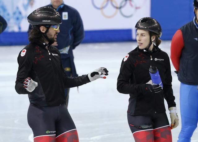 CCanadian short track speed skater Hamelin speaks to St-Gelais during practice in preparation for the 2014 Sochi Winter Olympics