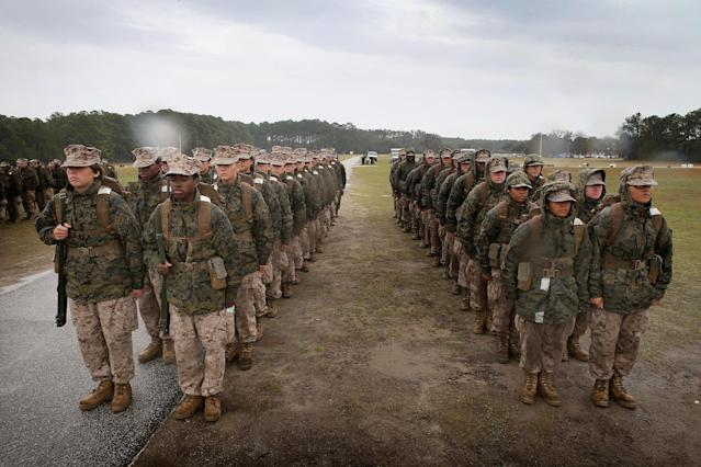 PARRIS ISLAND, SC - FEBRUARY 25: Female Marine recruits prepare to fire on the rifle range during boot camp February 25, 2013 at MCRD Parris Island, South Carolina. All female enlisted Marines and male Marines who were living east of the Mississippi River when they were recruited attend boot camp at Parris Island. About six percent of enlisted Marines are female. (Photo by Scott Olson/Getty Images)