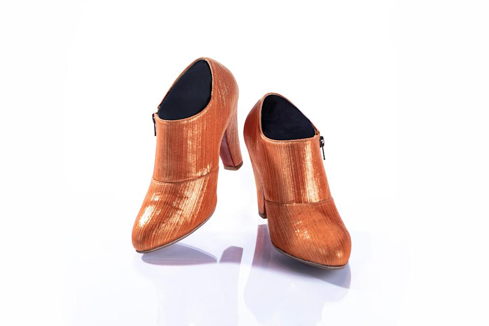 Prince wore these metallic orange Andre No. 1 shoes, complete with a matching suit, when he presented the Album of the Year Award at the 57th Annual Grammy Awards in 2015.