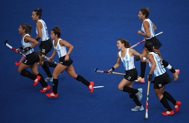 LONDON, ENGLAND - JULY 29: Carla Rebecchi of Argentina celebrates scoring her team's fifth goal during the Women's Pool WB Match W04 between Argentina and South Africa at the Hockey Centre on July 29, 2012 in London, England. (Photo by Daniel Berehulak/Getty Images)
