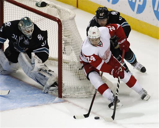 Detroit Red Wings' Damien Brunner (24) drives toward the goal as San Jose Sharks' Matt Irwin, behind, and goalie Antti Niemi defend during the second period of an NHL hockey game, Thursday, March 28, 2013 in San Jose, Calif. (AP Photo/George Nikitin)