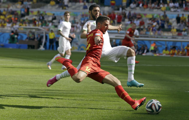 Belgium's Dries Mertens crosses the ball during the group H World Cup soccer match between Belgium and Algeria at the Mineirao Stadium in Belo Horizonte, Brazil, Tuesday, June 17, 2014. (AP Photo/Ricardo Mazalan)