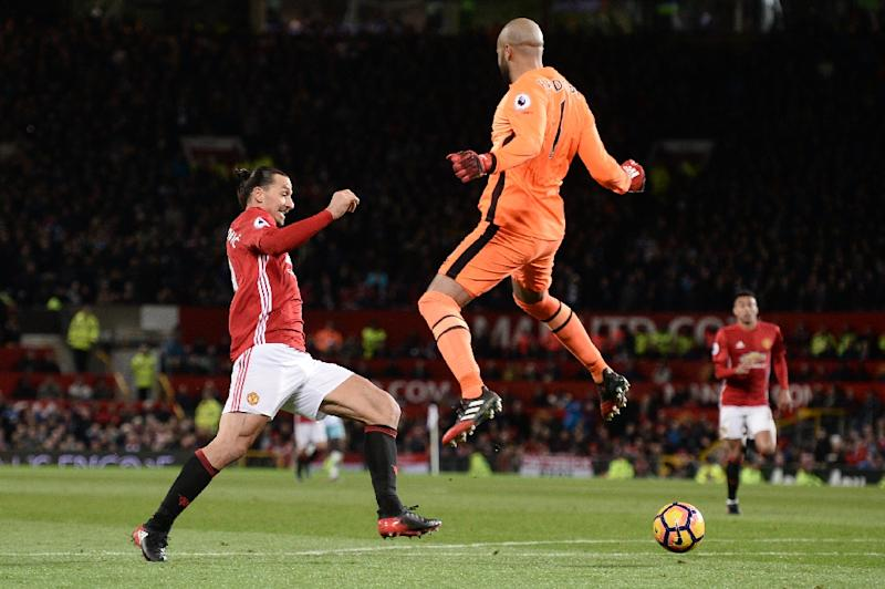 West Ham United's goalkeeper Darren Randolph jumps as he defends a shot from Manchester United's Zlatan Ibrahimovic during the match at Old Trafford on November 27, 2016 (AFP Photo/Oli Scarff)