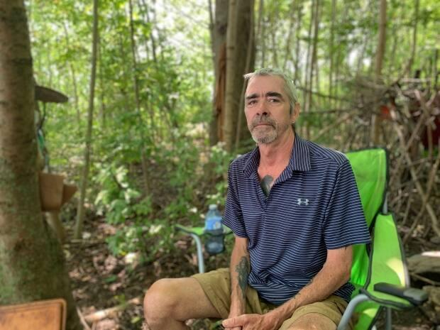 Allan DeYoung, 60, has been living in a wooden shelter in Dartmouth for months. (Shaina Luck/CBC - image credit)