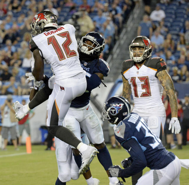 Tampa Bay Buccaneers wide receiver Chris Godwin (12) catches a touchdown pass in front of Tennessee Titans defenders Kendrick Lewis and Kenneth Durden (38) in the first half of a preseason NFL football game Saturday, Aug. 18, 2018, in Nashville, Tenn. (AP Photo/Mark Zaleski)