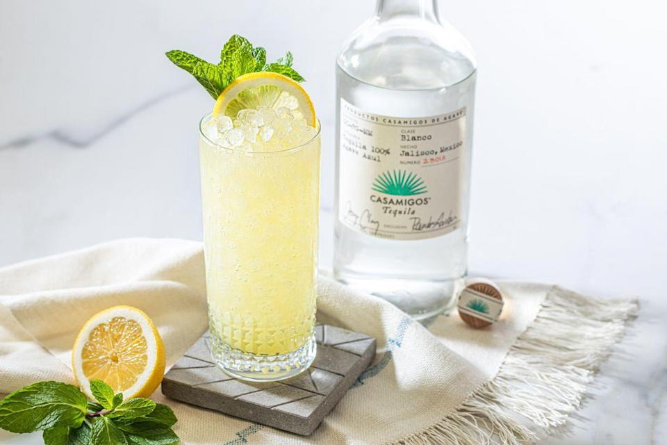 """<p>Create a refreshing tipple with George Clooney and Rande Gerber's tequila, Casamigos. Follow their delicious recipe below for a lemonade-mint cocktail, to sip as the sun sets. BT</p><p><strong>Ingredients</strong></p><p>60ml Casamigos Blanco Tequila</p><p>15ml fresh lemon juice</p><p>15ml simple syrup</p><p>8 to 10 mint leaves</p><p>Top up with lemonade </p><p><strong>Method</strong></p><p>Combine the ingredients, except the lemonade, into a shaker. Add ice and shake vigorously, then strain into a glass. Add ice, top up with lemonade and garnish with a lemon wheel and a sprig of mint. </p><p><a href=""""http://www.casamigos.com"""" rel=""""nofollow noopener"""" target=""""_blank"""" data-ylk=""""slk:www.casamigos.com"""" class=""""link rapid-noclick-resp"""">www.casamigos.com</a></p>"""
