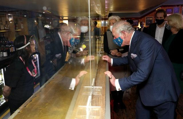 The Prince of Wales speaks to bar staff during a visit to the Soho Theatre. Chris Jackson