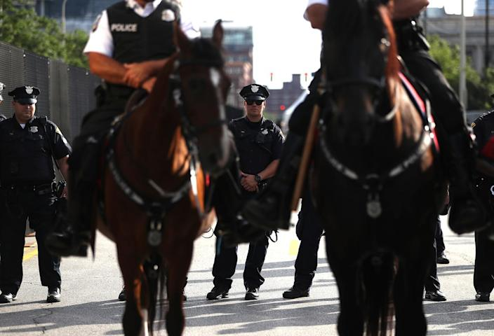 <p>Cleveland police officers block an intersection during a demonstration near the site of the Republican National Convention on July 17, 2016, in Cleveland, Ohio. (Photo: Justin Sullivan/Getty Images)</p>