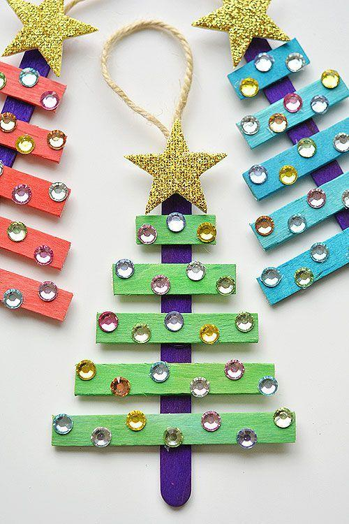 """<p>With the help of string, glue, and rhinestones, these colored popsicle sticks will look adorable on your real tree. </p><p><a href=""""https://onelittleproject.com/glittering-popsicle-stick-christmas-trees/"""" rel=""""nofollow noopener"""" target=""""_blank"""" data-ylk=""""slk:Get the tutorial at One Little Project »"""" class=""""link rapid-noclick-resp""""><em>Get the tutorial at One Little Project »</em></a></p>"""