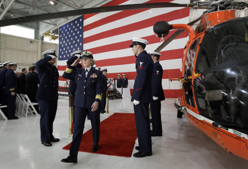 U.S. Coast Guard Rear Admiral Mary Landry salutes as she leaves a ceremony honoring members of offshore supply vessel Damon B. Bankston and Coast Guard helicopter crews who helped rescue 115 survivors of last year's Deepwater Horizon explosion at Coast Guard Air Station New Orleans in Belle Chasse, La., Friday, April 15, 2011. (AP Photo/Patrick Semansky)