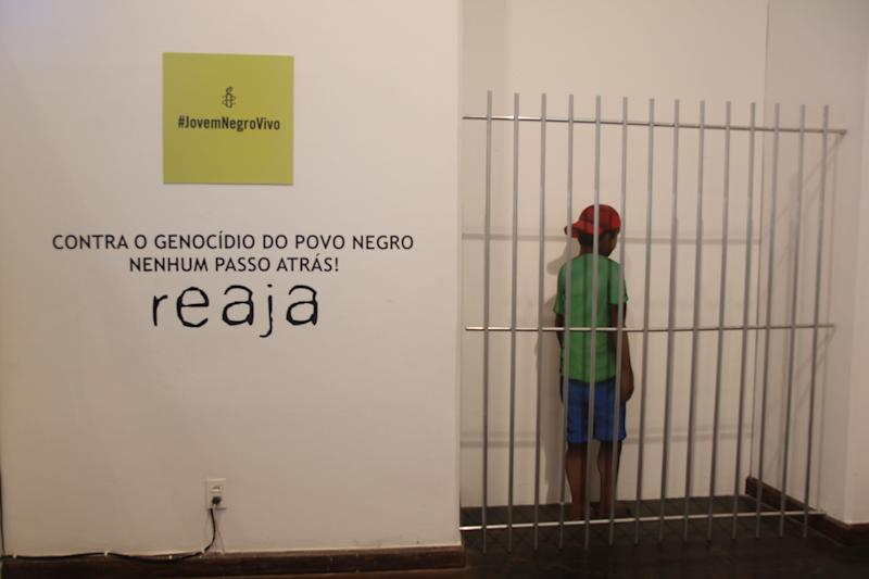 """A display in the Afro-Brazilian Museum in Salvador, Bahia shows a sign of Amnesty International's campaign called Joven Negro Vivo (""""Young Black Alive""""). The caption under it condemns the genocide of black youth."""