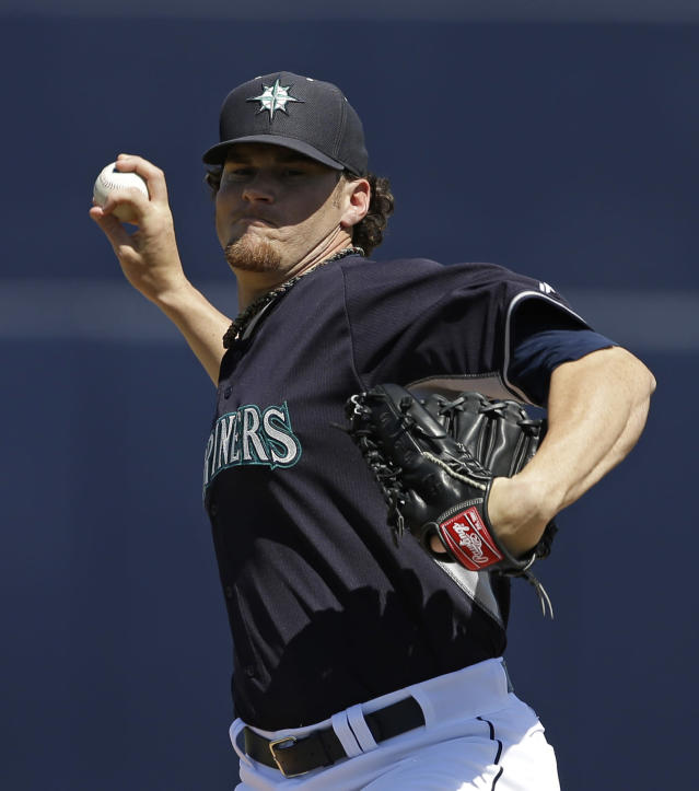 Seattle Mariners' Blake Beavan throws before the start of a spring exhibition baseball game against the Chicago White Sox Monday, March 24, 2014, in Peoria, Ariz. (AP Photo/Darron Cummings)